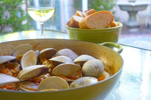 Grilled clams in chorizo white wine sauce