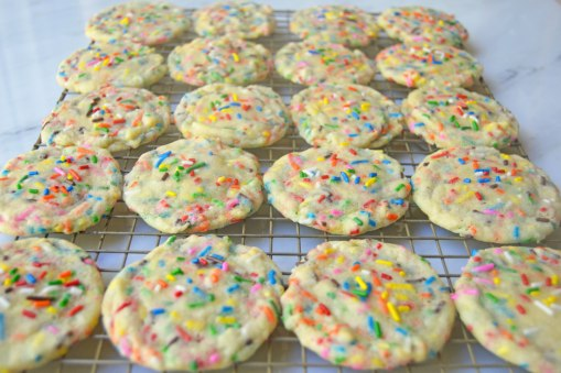 funfetti cookies on cooling rack